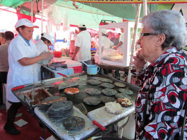 Alex Schmidt's paternal grandmother, Dora, orders <em>tlacoyos</em> in Mexico City.