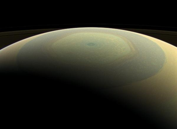 Saturn, looking something like a hand-painted ornament, in a newly released image from NASA.
