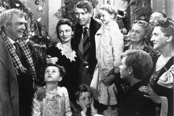 Worth living for: George Bailey, center, played by James Stewart, is reunited with his wife, Mary, played by Donna Reed, and his children in the final scene of Frank Capra's 1946 classic, <em>It's A Wonderful Life</em>.