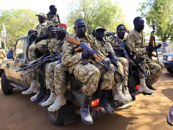 South Sudan soldiers ride on a truck in Bor, about 100 miles outside the capital, on Wednesday.