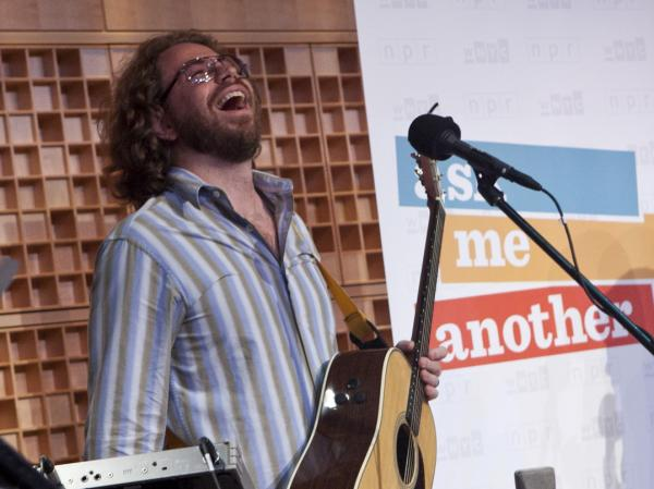 House musician Jonathan Coulton has a laugh while performing on <em>Ask Me Another.</em>