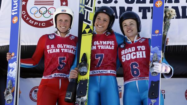 Jerome (center) with second-place finisher Lindsey Van (right) and third-place finisher Alissa Johnson after the women's ski jumping event.