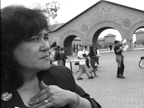 Cecilia Burciaga looks on as students protest the elimination of her position in April 1994.