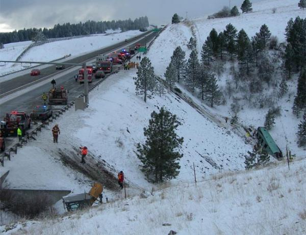 Emergency personnel at the scene of the deadly bus crash on Interstate 84 east of Pendleton in January 2013.