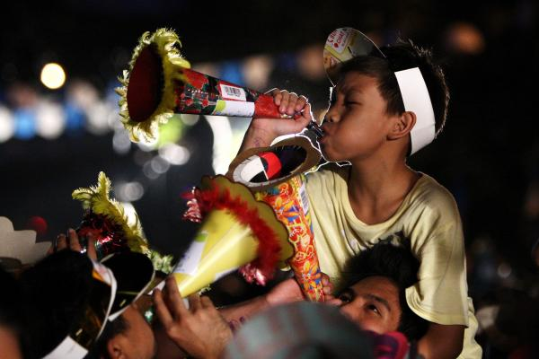 "Thousands of Filipinos toot their Torotots (party blowers) during an attempt to break the Guinness record for the ""most number of people blowing party blowers simultaneously"" in Davao city. Ten-thousand party blowers were expected to make noise there on New Year's Eve."