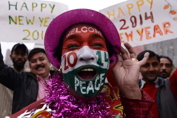 A reveler poses on New Year's Eve in Amritsar, India.