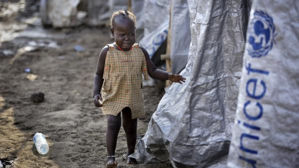 A young, displaced girl cries after the relative she was with disappears into a row of latrines Sunday at a U.N. compound in Juba, South Sudan. Violence in the country has forced an estimated 70,000 people to take refuge in U.N. compounds.