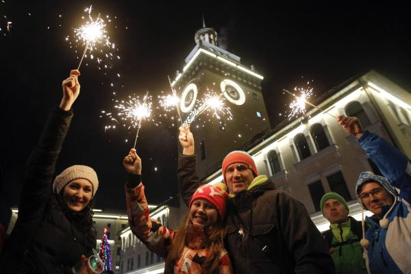 People celebrate ahead of New Year's Day in the center of Rosa Khutor, a venue of the Sochi 2014 winter Olympics.