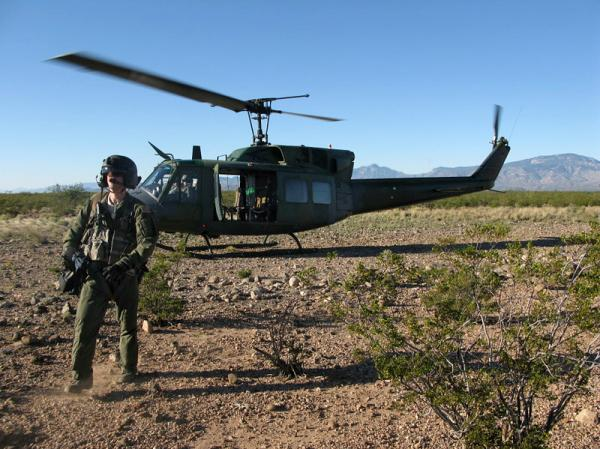 <p>A member of a helicopter flight crew participating in Operation Angel Thunder walks across the desert in southern Arizona.</p>