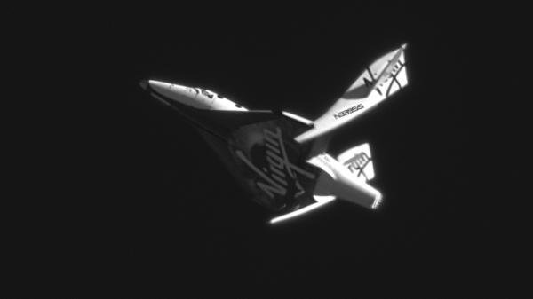 <p>SpaceShipTwo in full feather wing mode on a rapid descent from its drop altitude of 51,500 feet over Mojave, Calif. in May of 2011. This photograph was taken with high powered telescopes from the ground.</p>