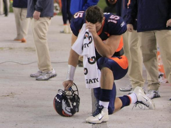 "Denver Broncos quarterback Tim Tebow bows his head on the sidelines — the gesture that's been enshrined as ""tebowing"" — after scoring a touchdown against the New York Jets on Nov. 17. With Tebow at the helm, the Broncos have won six in a row."