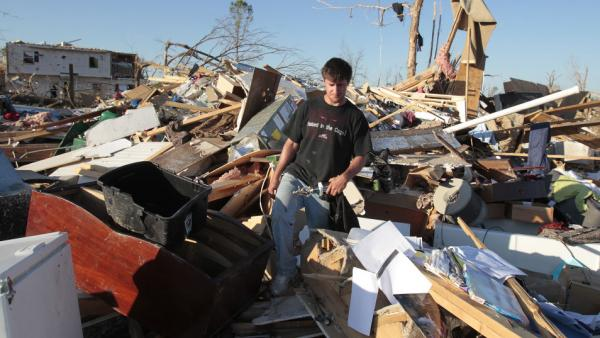 Tornado survivor Jonathan Ford saves what he can from his home April 29, 2011, after it was destroyed by a powerful tornado in Pleasant Grove, Ala.