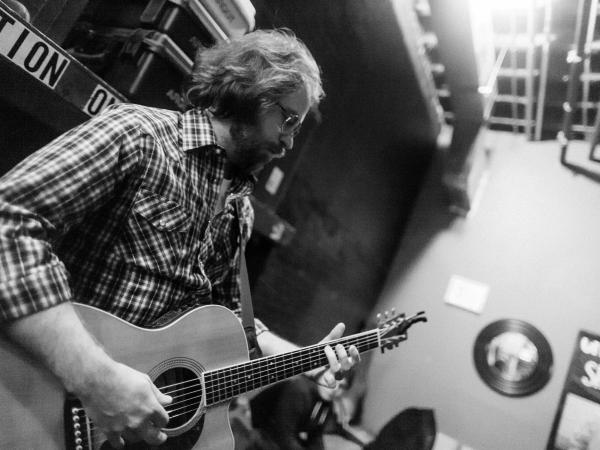 Jonathan Coulton, resident musician for <em>Ask Me Another,</em> backstage before the show's final taping during season one at The Bell House in Brooklyn, NY.