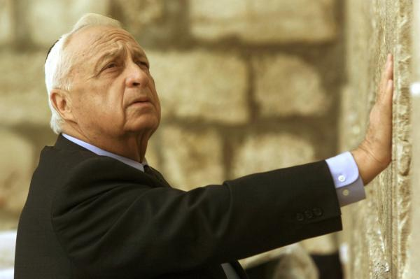 Sharon, who was then Israel's prime minister-elect, looks up as he touches the holiest site of Judaism, the Western Wall, in Jerusalem on Feb. 7, 2001.