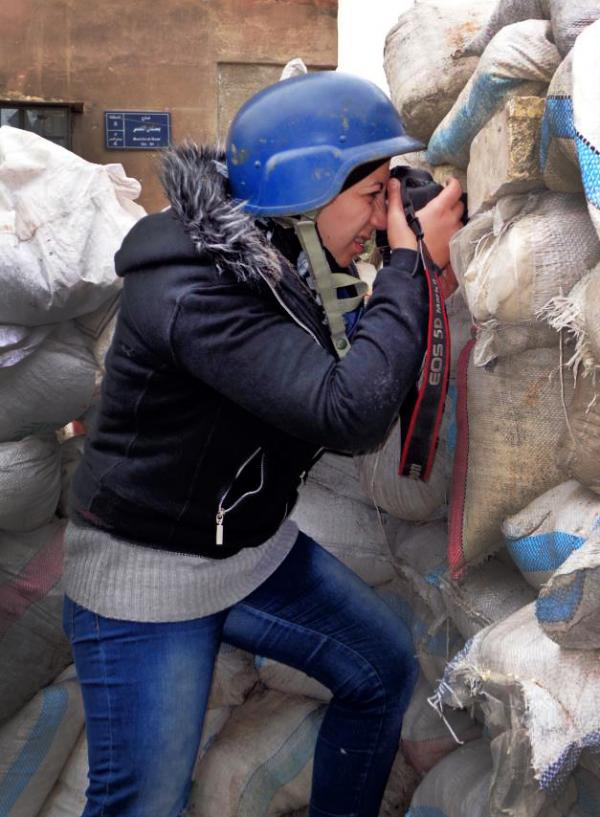 Nour Kelze, a 25-year-old from Aleppo, Syria, was teaching English at a private school when the uprising started two years ago. Since then, she has learned to be a war photographer and has been sending photos to the Reuters news agency.