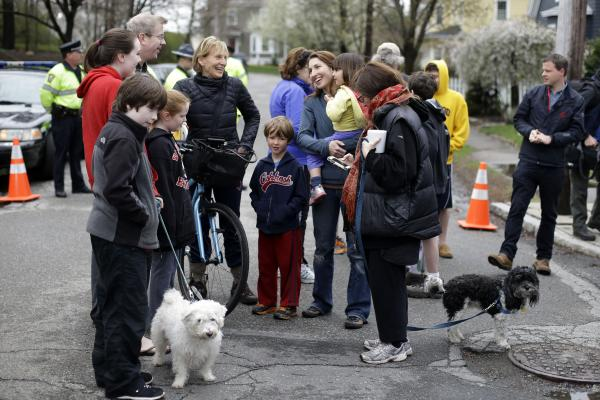 Neighbors gather near the location where Tsarnaev was arrested.