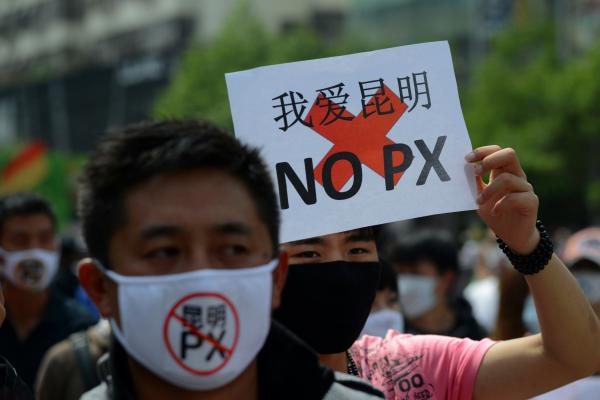 Protesters demonstrate against plans for a factory to produce paraxylene, a toxic chemical used to make fabrics, in China's Yunnan province on Saturday. In nearby Chengdu, planned protests were thwarted.
