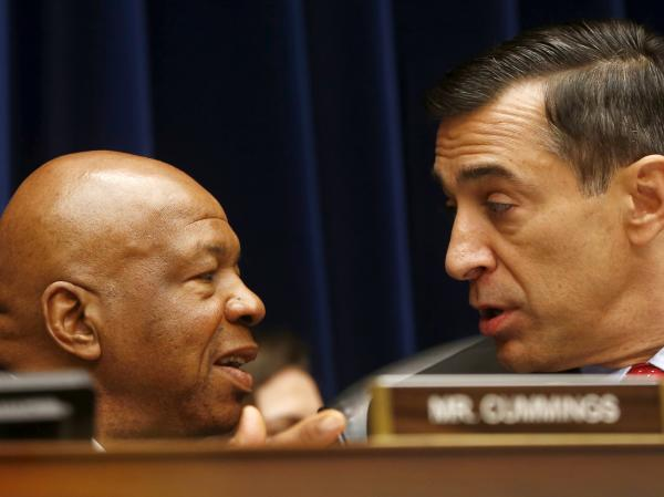 House Oversight and Government Reform Committee Chairman Darrell Issa (right) speaks with the committee's ranking Democrat, Elijah Cummings, earlier this month, during a hearing on IRS conference spending.