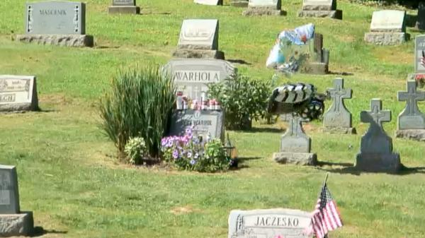 An image taken from streaming video at The Andy Warhol Museum's site shows the artist's grave in Pittsburgh today. The museum is streaming video from the cemetery to honor Warhol's birthday.