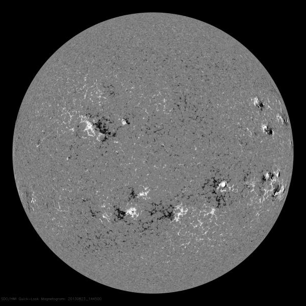 This image shows the magnetic field directions near the surface of the sun. White and black areas indicate opposite magnetic polarities, with white showing north (outward) polarity and black showing south (inward) polarity.