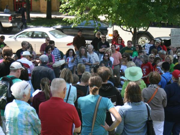 Members of a loosely organized, anti-Walker group known as the Solidarity Singers sing outside the Wisconsin Capitol in July.