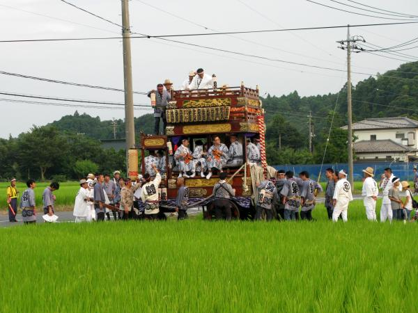 Rice farmers pull a harvest festival cart down country lanes in Narita city, Chiba prefecture. The area is home to Tokyo's main airport, but also has many agricultural areas.