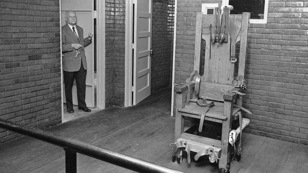 Execution witness Don Reid stands in the death chamber of the Texas State Penitentiary on July 31, 1972, where he officially watched 189 men die in the heavy oak electric chair. The Supreme Court struck down capital punishment on June 29 of that year.