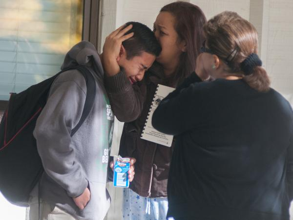 A Sparks Middle School student cries after Monday's shooting in Sparks, Nev.