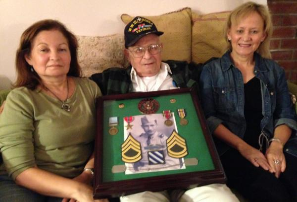 World War II veteran Luis Rodriguez, 91, is pictured with his daughters, Judy and Beth. (Lucy Nalpathanchil/WNPR)