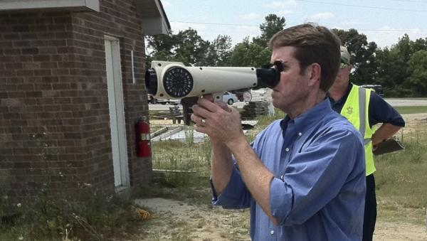 A man uses the Nasal Ranger to detect smells in the southern U.S., in this photo provided by St. Croix Sensory. In Denver, the device is being used to monitor complaints of strong marijuana smells.
