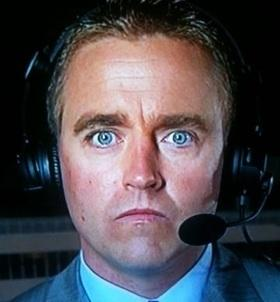 An ESPN sportscaster reacts to a small earthquake.