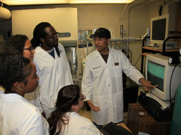 Fisk University physics student Terreka Hart (foreground, left) looks on with a group of students from the Bridge Program — Melanie Brady, Bobby Jones, Rose Perea (seated) and Brenden Wiggins (pointing).