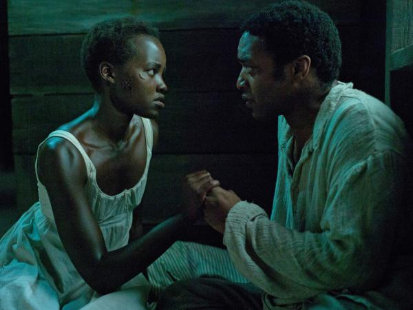 Lupita Nyong'o and Chiwetel Ejiofor play Patsey and Solomon, two slaves on a Louisiana plantation, in <em>12 Years a Slave</em><em>.</em>