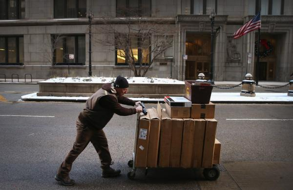 A UPS worker delivers packages on December 26, 2013 in Chicago, Illinois. Bad weather and a higher than expected demand from online sales caused FedEx and UPS to miss many Christmas delivery deadlines. (Scott Olson/Getty Images)