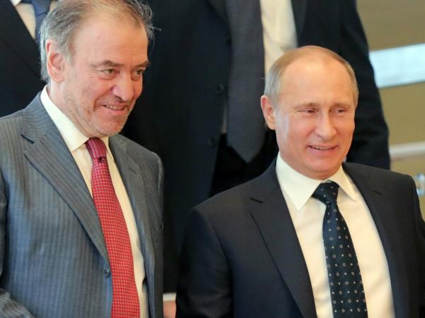 Russian conductor Valery Gergiev (left) has been criticized for not opposing Russia's anti-gay legislation, backed by President Vladimir Putin (right).