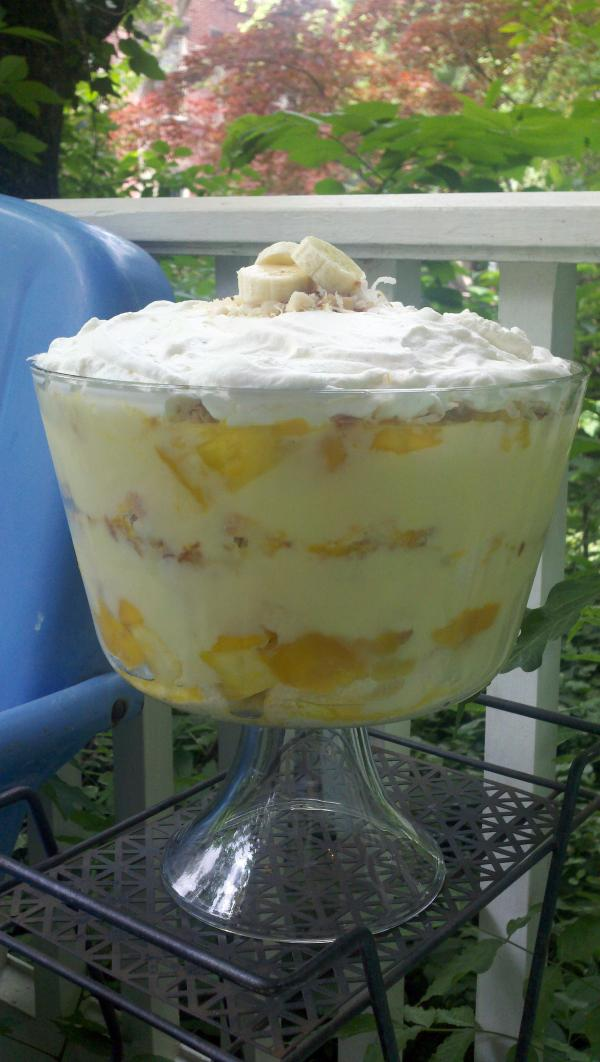 Rina Rapuano's Tropical Rum Trifle combines coconut-rum-soaked angel food cake, custard, fresh fruit and macadamia nuts.