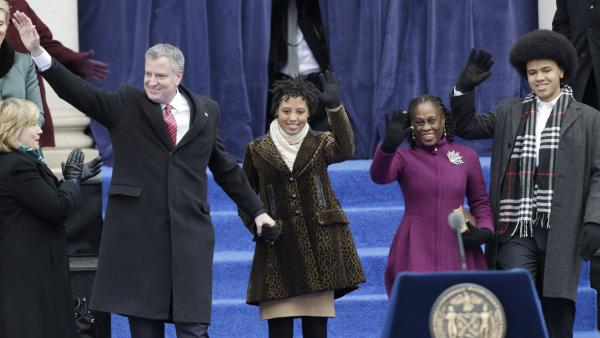 New York City Mayor Bill de Blasio (from left) arrives with his family Chiara de Blasio, Chirlane McCray and Dante de Blasio to take the oath of office on the steps of City Hall on Wednesday.