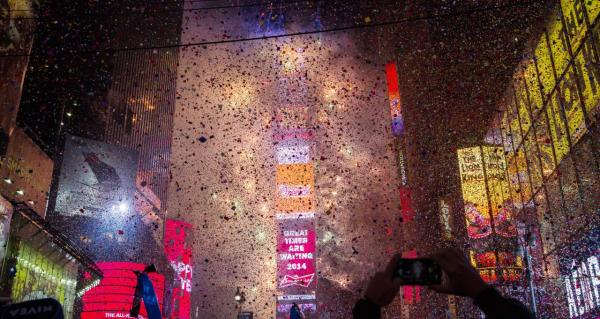 Confetti falls throughout Times Square during the New Years Eve celebration on January 1, 2014 in New York City. Economists are also among those who are optimistic for the new year. (Christopher Gregory/Getty Images)