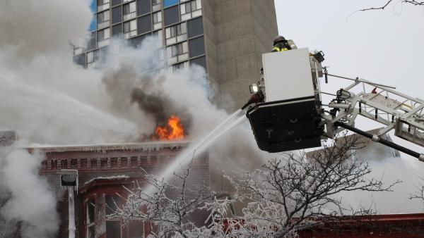 Crews battle a Minneapolis apartment fire on Wednesday. The billowing fire engulfed a three-story building, sending 14 people to hospitals with injuries ranging from burns to trauma associated with falls.