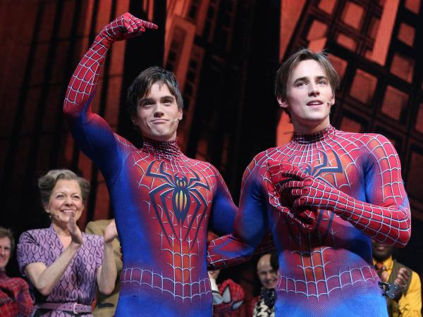 Reeve Carney (right) handed off the lead role in <em>Spider-Man: Turn Off the Dark</em> to successor Justin Matthew Sargent in September 2013. The show closes Jan. 4, and the Smithsonian Institution announced today that it's acquiring Carney's costume.