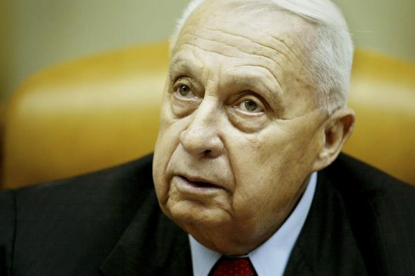 Sharon pauses during the weekly Cabinet meeting in his Jerusalem office on Jan. 30, 2005.