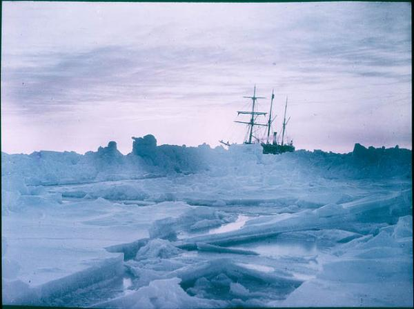 "Th ship, ""The Endurance"" got stuck in Antarctic ice for 15 months. Pictured, A mid-winter glow on the Weddell Sea surrounds The Endurance in 1915. (Frank Hurley/State Library of New South Wales via Flickr)"