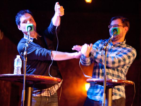 Michael Ian Black (left) battles World Series of Poker champion Matt Matros in a poker-themed battle of wits.