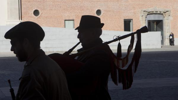 Street musician Valentino Juanino, right, plays his bagpipe at the Conde Duque Cultural Center last month after taking a quality test to obtain official permission to perform in the streets of Madrid.