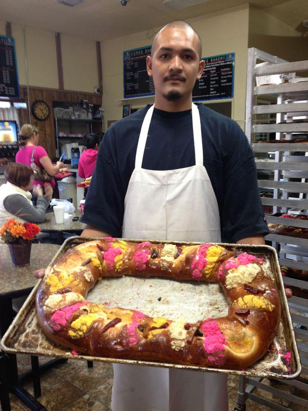 Alejandro Vacscez, 22, has been baking since he was 11 years old. He says the bakery will make close to 1,000 of these traditional breads for Three Kings Day.