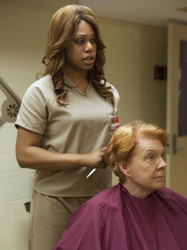 Laverne Cox, left, plays Sophia, a transgender character in Netflix's <em>Orange is the New Black</em>.