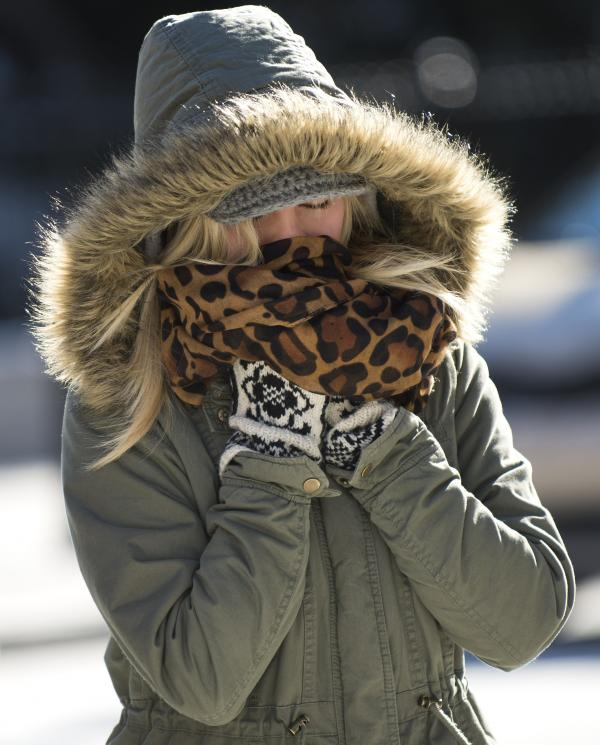 Brrr. This woman was cold Friday in Washington, D.C. But even more frigid temperatures are descending on much of the nation.