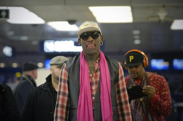 Former NBA basketball player Dennis Rodman waits to check in for his flight to North Korea after his arrival at Beijing's international airport on Monday.