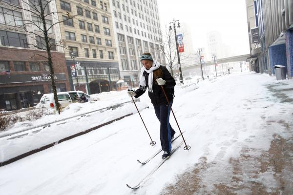 Alison Mueller skies to work through several inches of snow in Detroit as the area deals Monday with record-breaking freezing weather. Wind chill has driven temperatures in Michigan and much of the Midwest down to 50-70 degrees below zero.