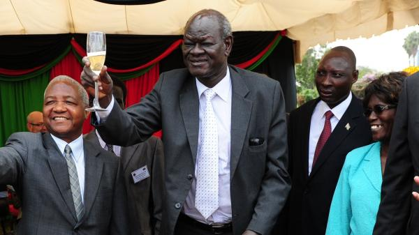 South Sudan's then-Minister of Higher Education, Science and Technology Peter Adwok Nyaba (center) celebrates the first anniversary of the country's independence in Nairobi, capital of Kenya, on July 9, 2012. Since then, all of South Sudan's Cabinet ministers have been sacked — including Adwok — for allegedly conspiring to overthrow President Salva Kiir.